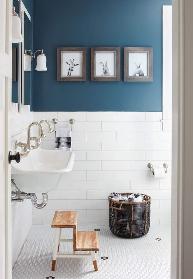 modern farmhouse bathroom with cerulean blue paint and white subway tiling