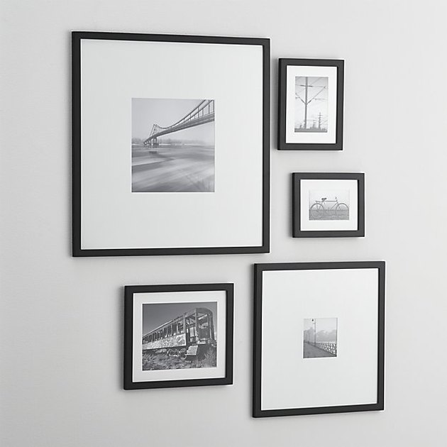 Five black picture frames in various sizes