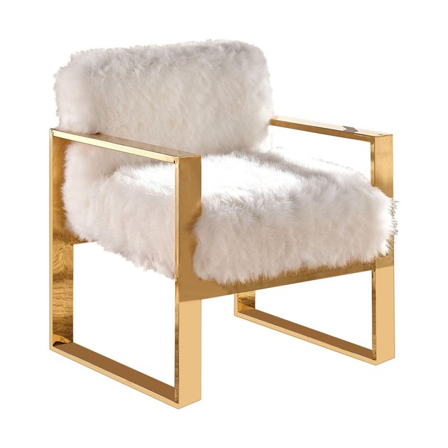 White faux fur accent chair with gold details