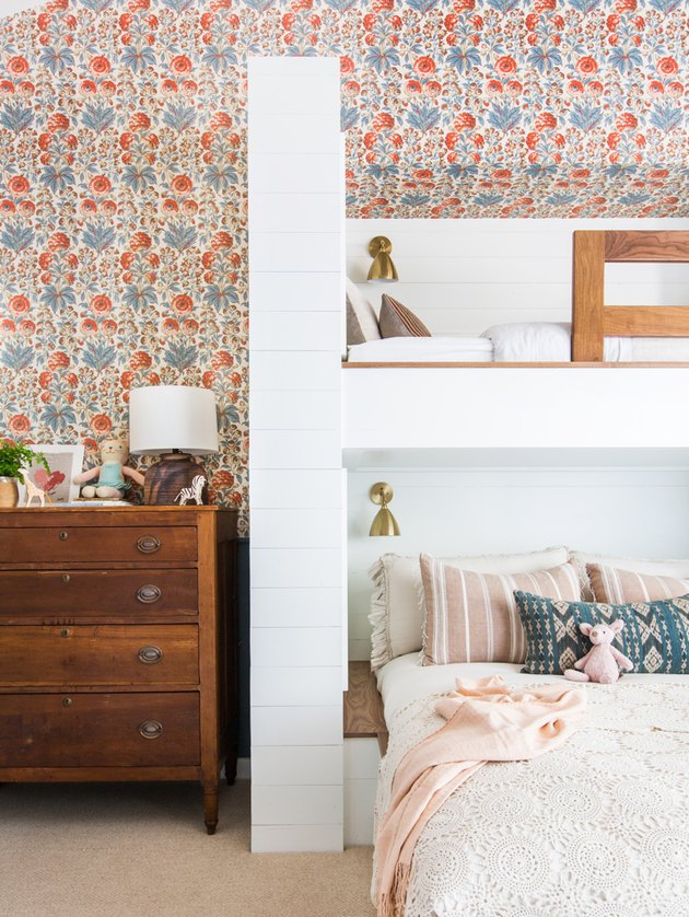 little kids bedroom with floral wallpaper and bunk beds