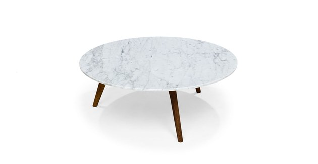 White round marble-inspired mid-century coffee table with wooden legs