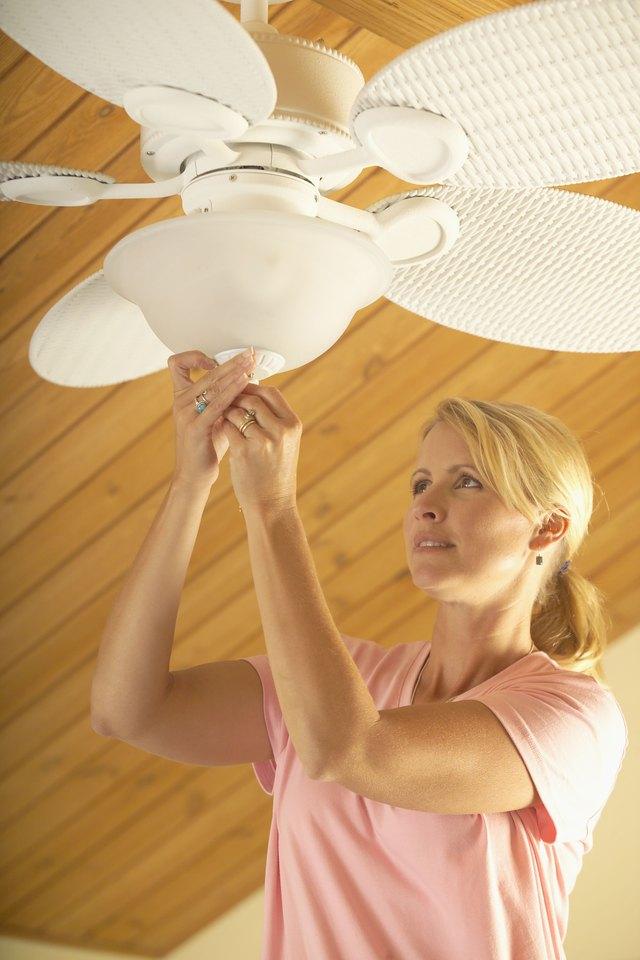 What to do about noisy bearings in a ceiling fan hunker fan bearings woman adjusting ceiling fan aloadofball Gallery