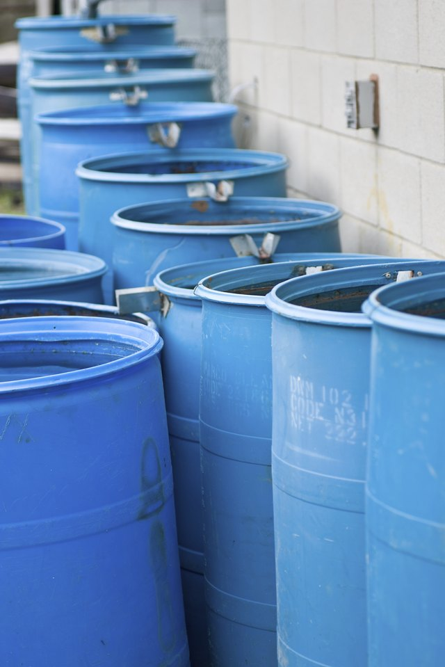 Blue rain barrels in a row flowing into each other