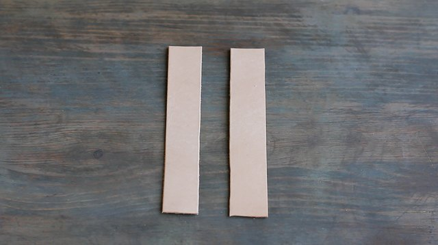 Two strips of tooling leather