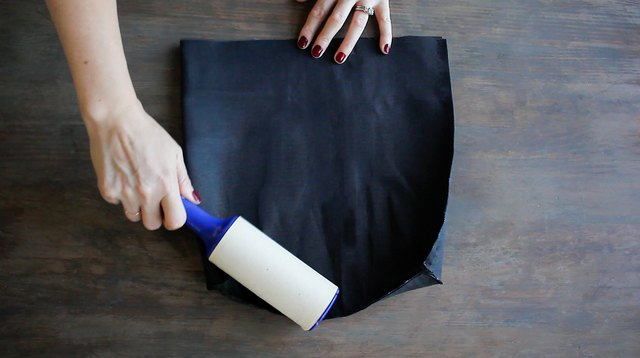 Lint rolling over fabric to remove dust or lint