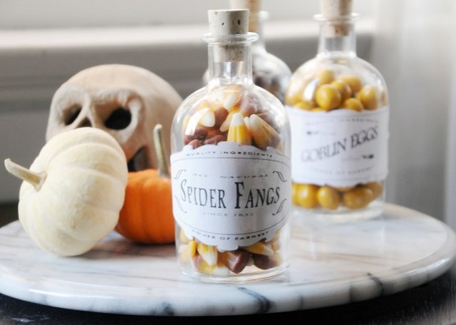 glass jars filled with candy and Halloween inspired labels