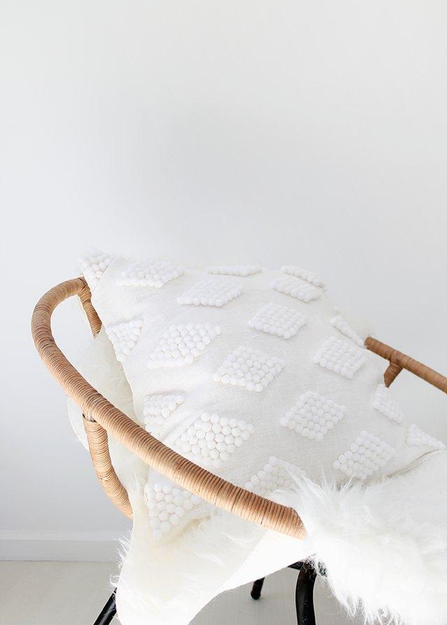 DIY white throw pillow with diamond pattern detail
