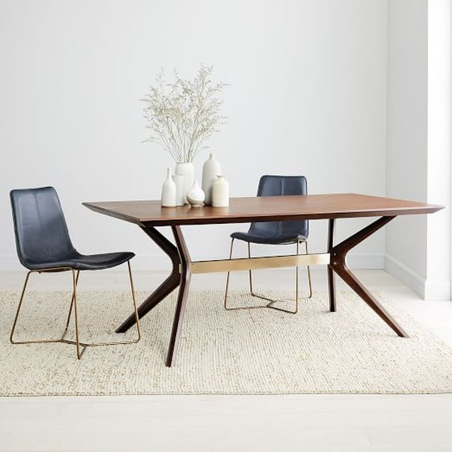 Boomerang base wooden dining table