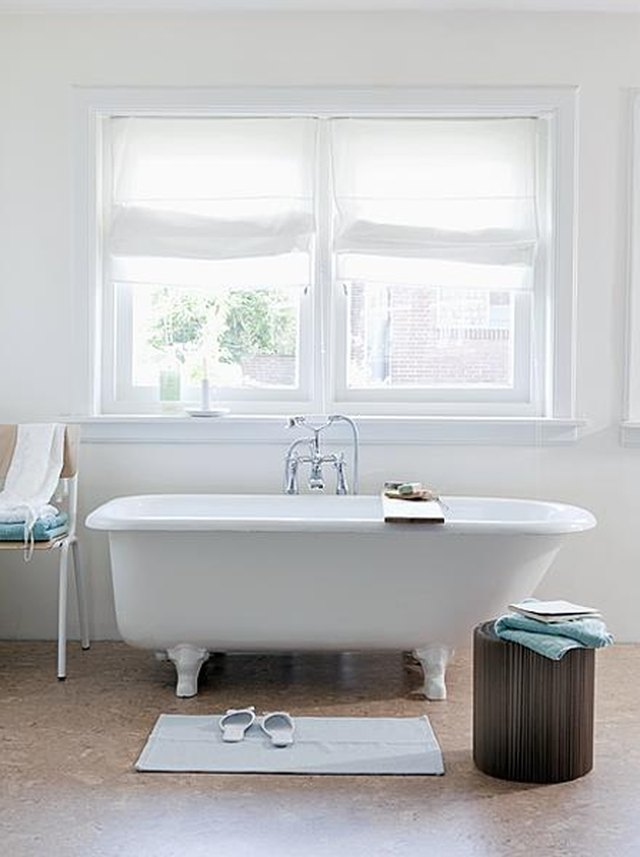 white bathroom with cork flooring and Roman shades