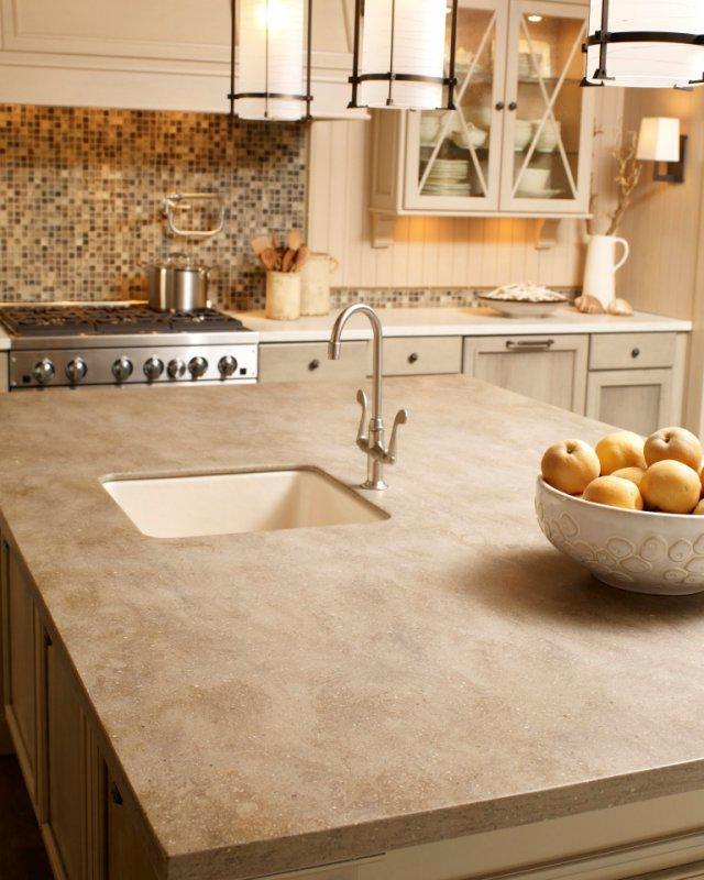 Kitchen island with solid surface countertop.