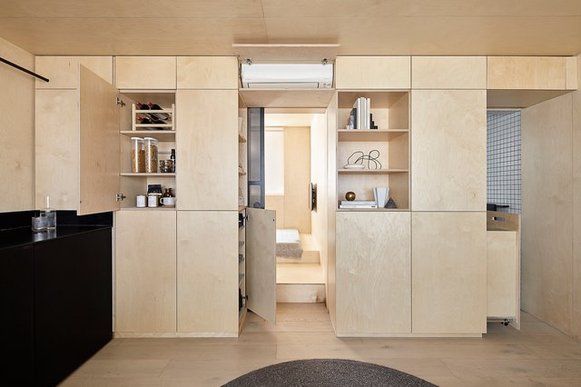 """A """"Micro Unit"""" Studio in Australia Is Packed With Plywood Storage 