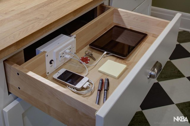 A drawer with an outlet that includes phone charging ports.