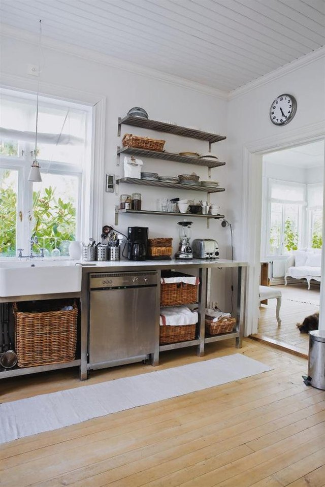 Kitchen with open shelves and wicker baskets.