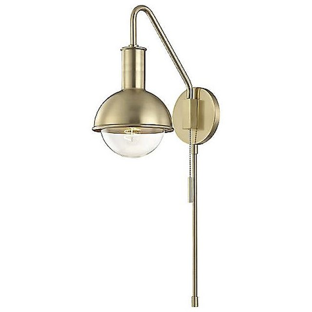 Brass swing arm wall sconce with round bulb half-covered by brass dome