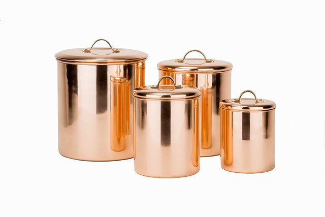 Set of four copper canisters