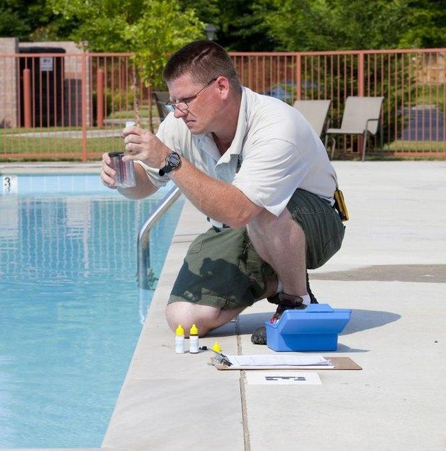 Man testing pool chemistry.
