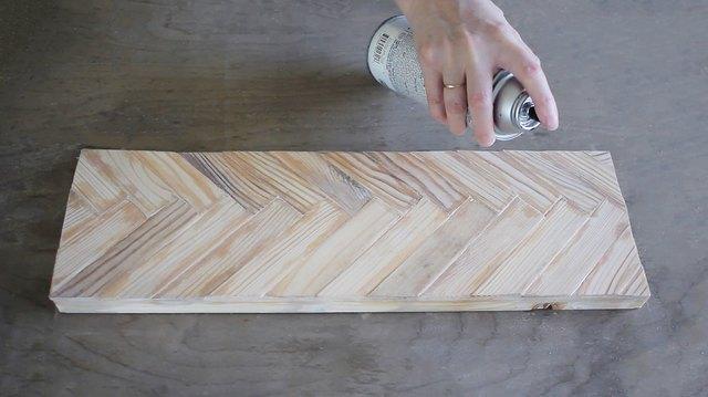 Spraying clear coat finish onto knife rack