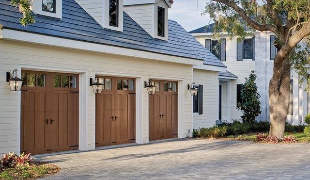 Sconces next to wooden Craftsman doors