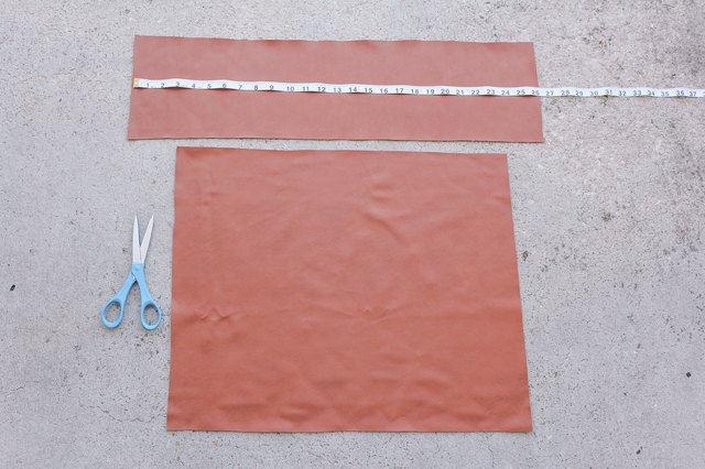Faux leather fabric pieces cut out for chair back and seat
