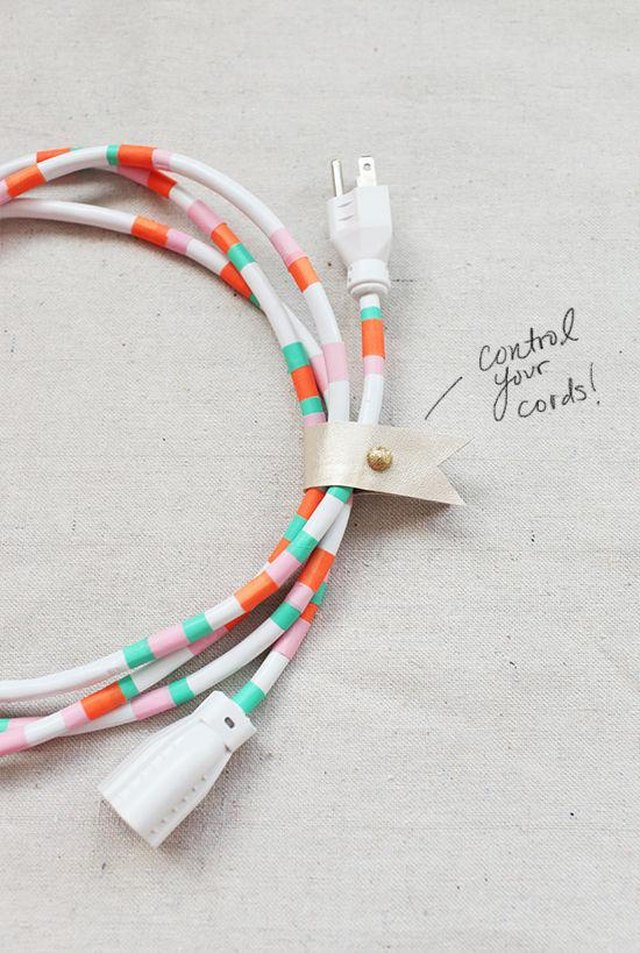 A white cord with colorful washi tape