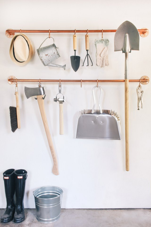 Copper pipe garage storage organization