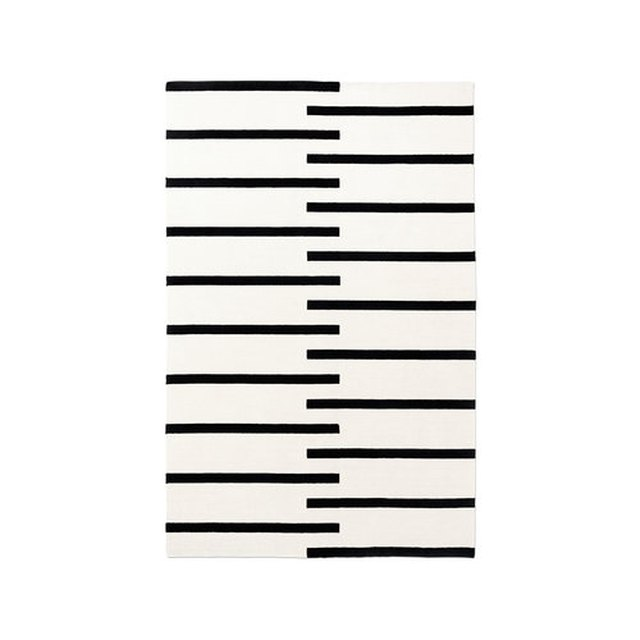 Cream rug with bold black stripes