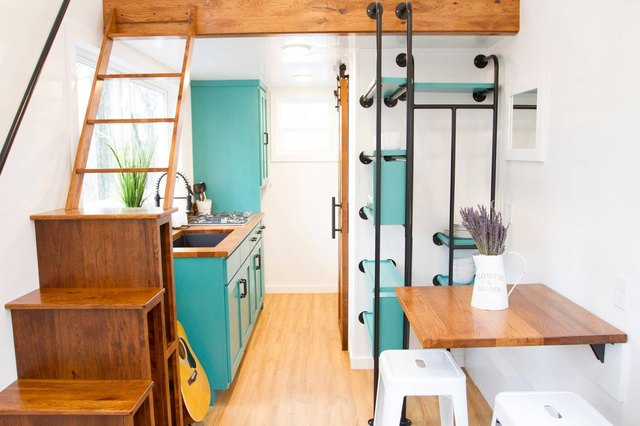 Interior shot of tiny cabin with teal accents.