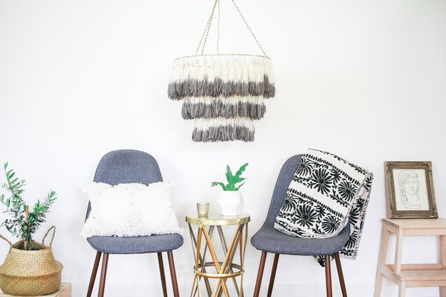 Tassel chandelier hanging above two chairs