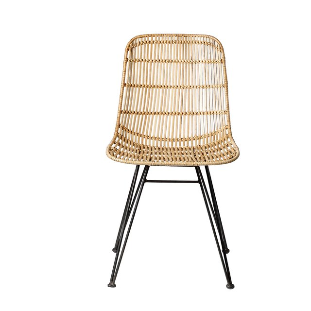Finely woven armless rattan dining chair with black metal legs