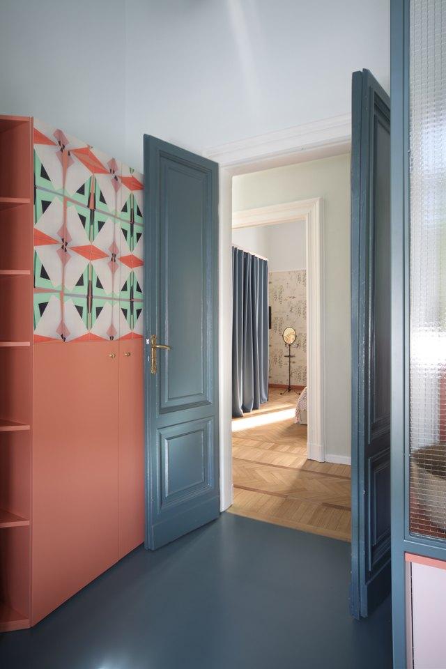 blue floors and blue doors in bathroom