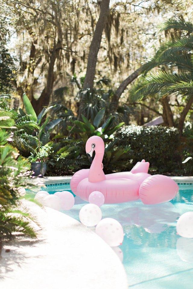 pink flamingo pool float in pool