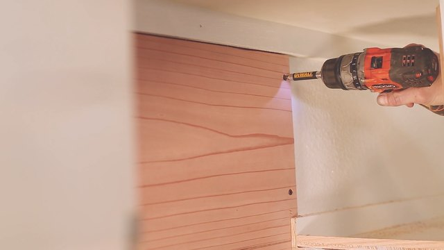 Drilling redwood board to back of cabinet