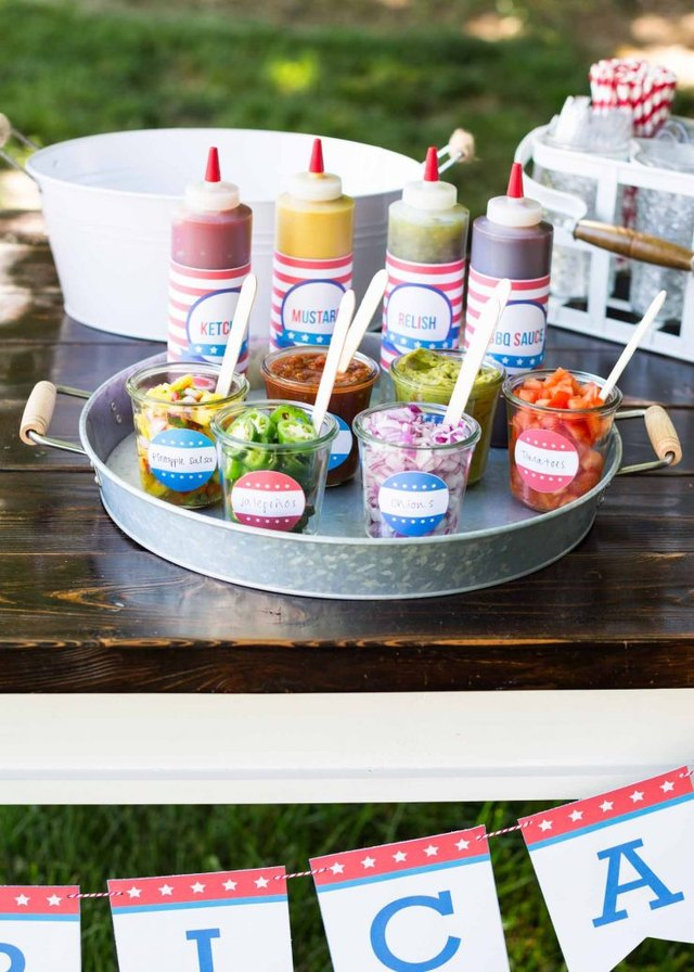 Condiments and toppings on an aluminum tray