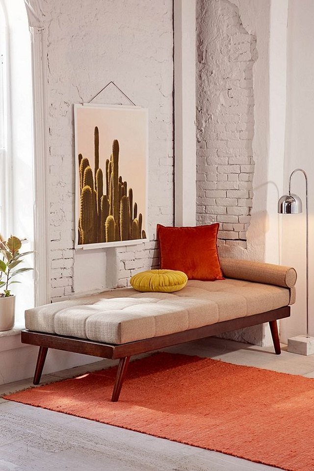 urban outfitters midcentury daybed with white brick wall