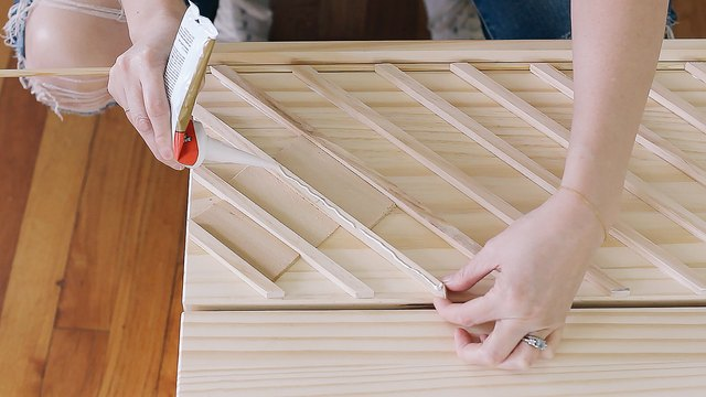 Gluing dowels to first drawer