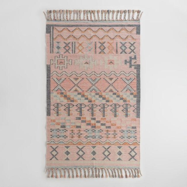 Blush-dominant kilim rug with gray and light blue details