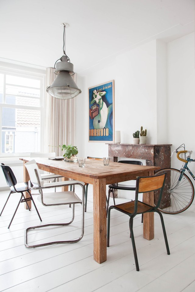dining room with rustic table and mismatched chairs