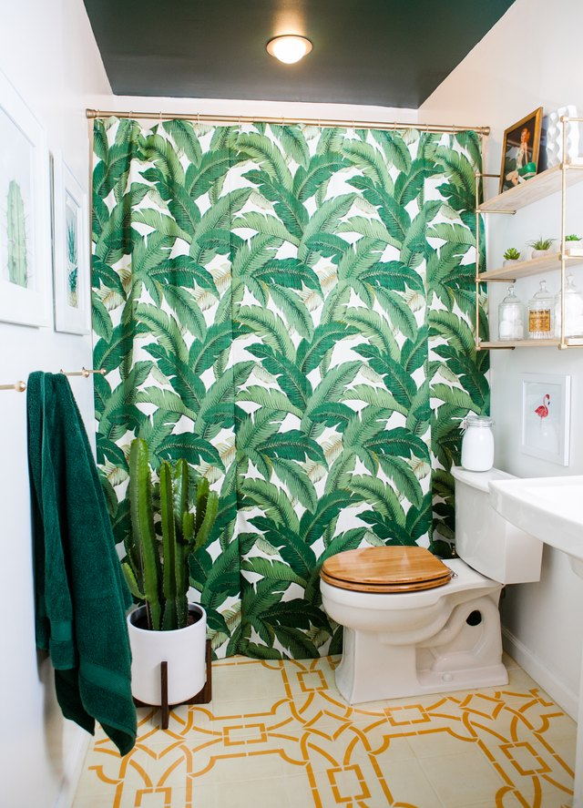 bathroom with stenciled tile and unique shower curtain