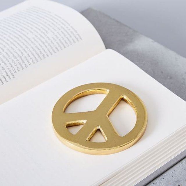 brass peace sign paperweight