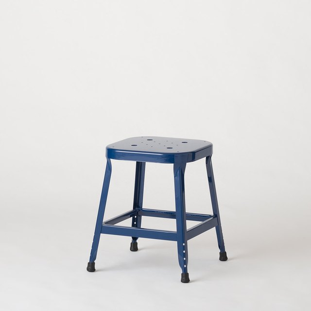 Small navy blue metal industrial utility stool