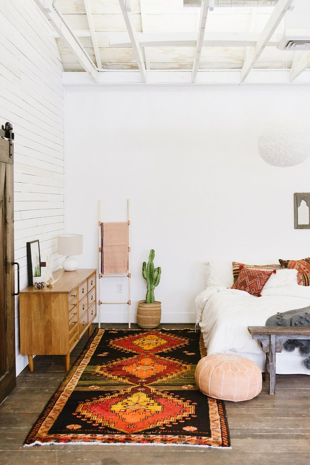 bohemian bedroom with pillows on bed
