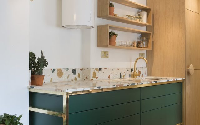 Pair Terrazzo Countertops With A Bold Hue.