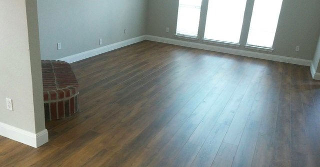 New laminate floor with baseboards.