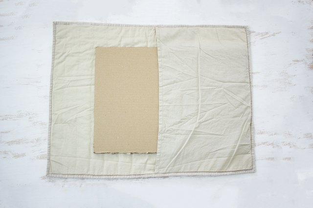 Placing cardboard inside pillow sham