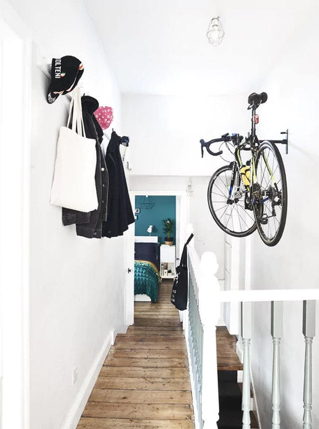 hanging bike rack in hallway with wall hooks