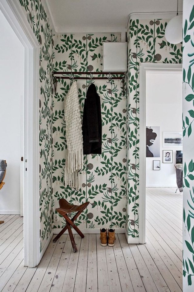 foliage covered wallpaper in small hallway