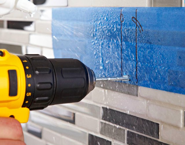 Drilling through a shower wall.