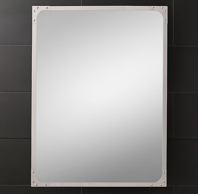 Rectangular wall mirror with chrome border and small chrome rivets in each corner