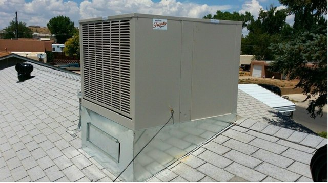 A rooftop evaporative cooler.