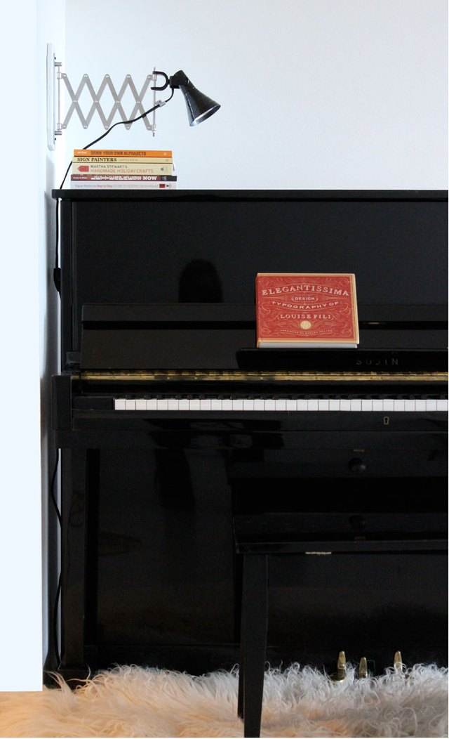 A sconce over a piano
